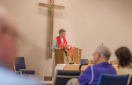 Rev. Evan preaching (c) 2015 Jacob Walker